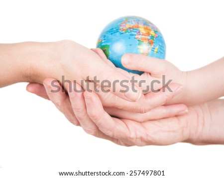 Hands of a child, a man and a woman holding a globe - stock photo