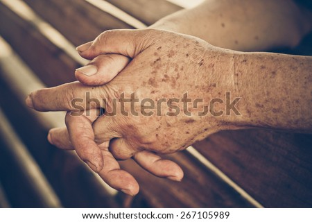 hands of a female elderly - stock photo