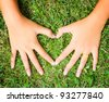 Hands of a loving couple shaping a heart - stock photo