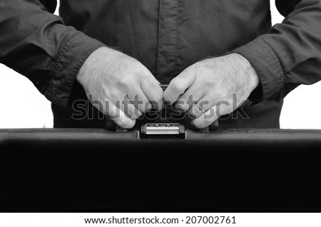 Hands of a man carry travel suitcase against white background with copy space. Concept photo of travel, vacation, holiday, destination, tourism, traveler, tourist. (BW) - stock photo
