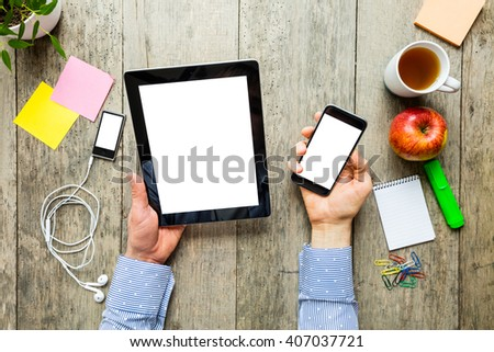 hands of a man holding electronic devices - stock photo