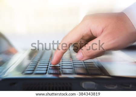 Hands of a man working with computer