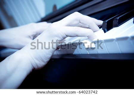 hands of a piano player - stock photo