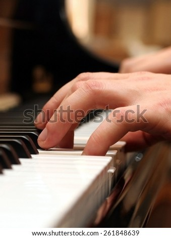 Hands of a piano playing musician in a sensitive mood - stock photo