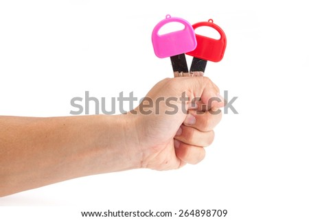 Hands of a picked up key 2 keys In a manner delivery or submit to or offer an alternative. - stock photo