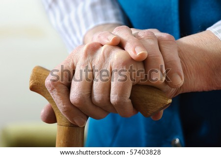 hands of a senior woman on cane - stock photo