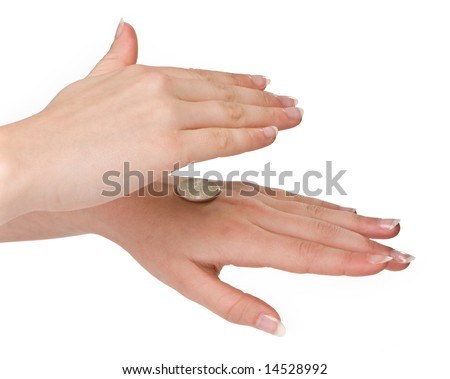 Hands of a woman checking heads or tails - stock photo
