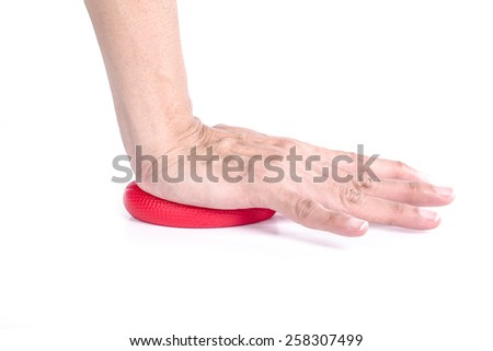 Hands of a woman crushing a stress ball - stock photo
