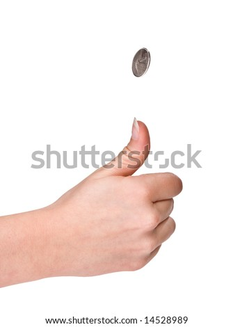 Hands of a woman flipping a coin - stock photo