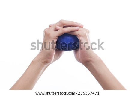 Hands of a woman squeezing a stress ball  - stock photo