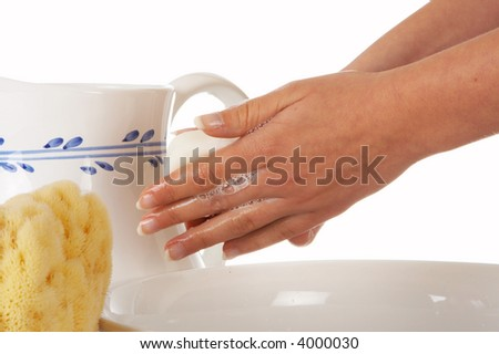Hands of a woman washing her hands with soap and water