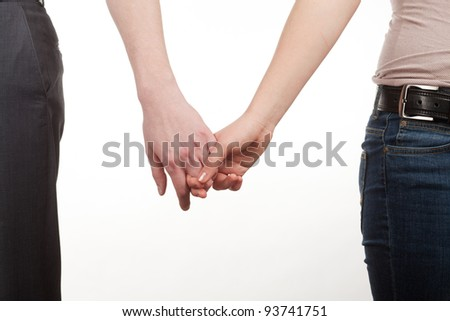 hands of a young couple hooked up together