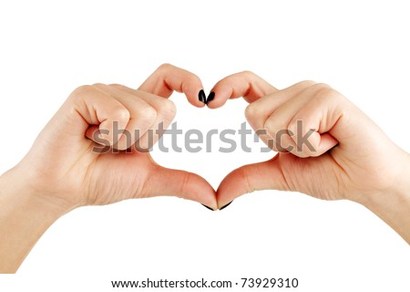 Hands of a young female making a hearth shape, clipping path - stock photo