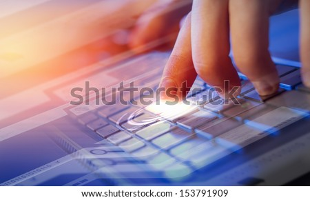 Hands of a young man on the keyboard with the elements. Collage. - stock photo