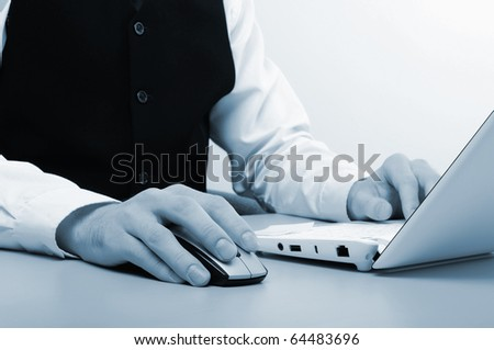 Hands of a young man working on the computer in the office. - stock photo