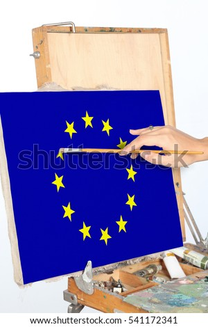 Hands of a young woman drew a European Union flag.