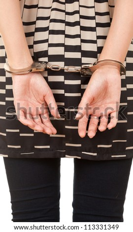 hands of a young woman in handcuffs, white background - stock photo