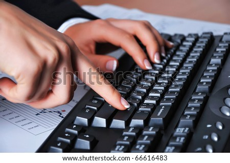 Hands of a young woman presses the keyboard. Workplace businessman