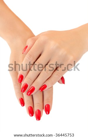 Hands of a young women.  Red nail polish - stock photo