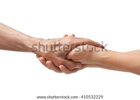 Hands of an elderly man holding the hand of a younger woman, isolated white background - stock photo