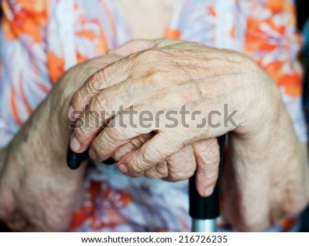 Hands of an elderly woman - stock photo