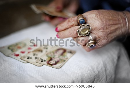 Hands of an old fortuneteller. - stock photo