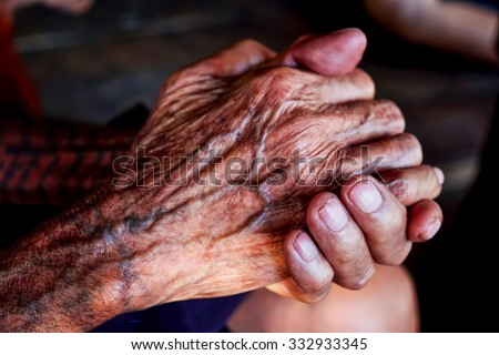 Hands of an old man - stock photo