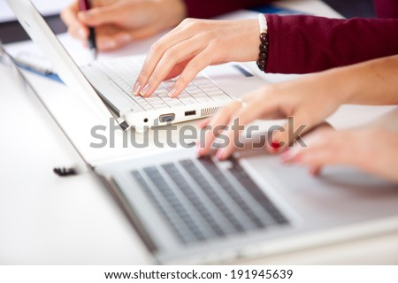 Hands of an student typing on laptop - stock photo