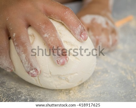 Hands of asian boy and digging of the egg dinosaur toy - stock photo