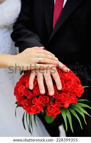Hands of bride and groom. - stock photo