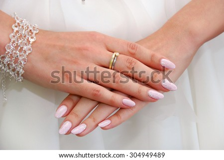 hands of bride with engagement ring on finger before wedding
