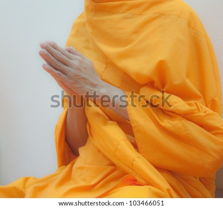 Hands of Buddhist monk praying for the Buddhist - stock photo