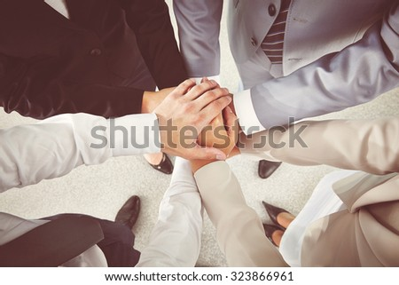 Hands of business partners making pile - stock photo