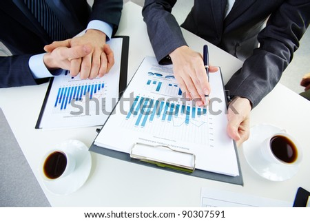 Hands of business people and documents - stock photo