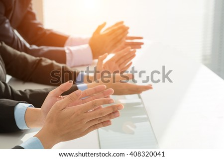 Hands of business people clapping to speaker - stock photo