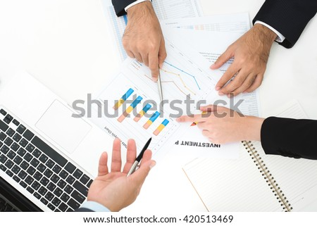 Hands of business people discussing documents in the meeting - stock photo