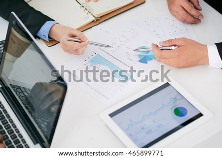 Hands of business people discussing financial chart at the meeting