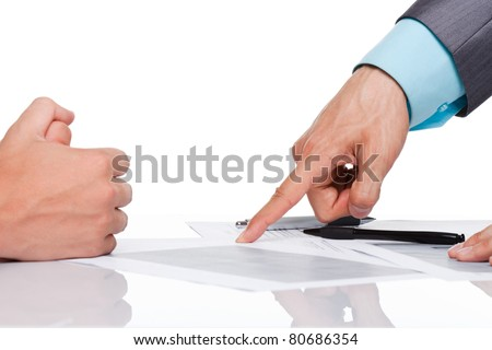 Hands of business people in elegant suits sitting at desk working in team together, with document point finger on paper sign up contract, concept, business plan. Isolated over white background - stock photo