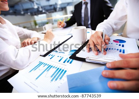 Hands of business people over documents - stock photo
