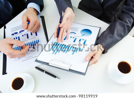 Hands of business people working with documents - stock photo