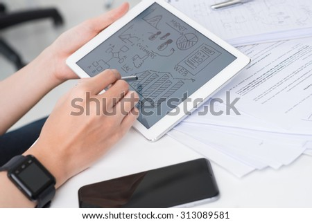 Hands of business person drawing ideas for start-up project on tablet computer