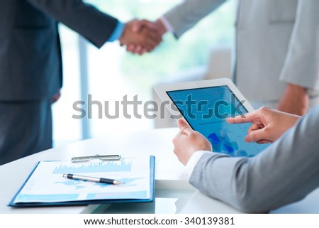 Hands of business person working with chart on the digital tablet