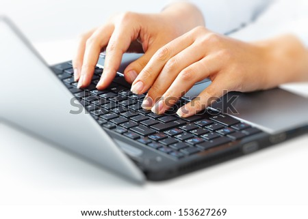 Hands of business woman with laptop computer keyboard. - stock photo