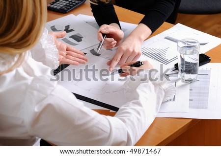 Hands of business women are actively discussing the business project. Workplace business woman. - stock photo