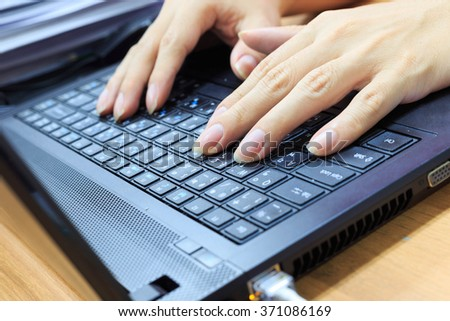 Hands of businessman typing on laptop notebook