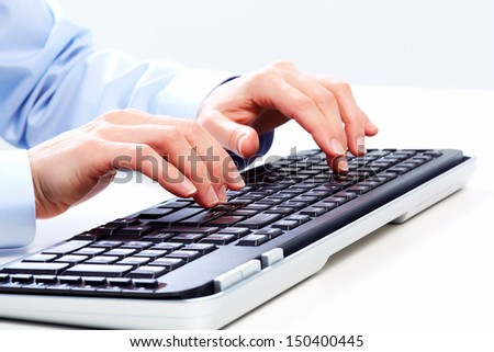 Hands of businessman with a computer keyboard. - stock photo