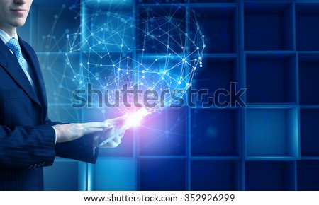Hands of businessman with tablet pc against high tech background
