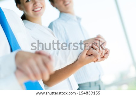 hands of businessmen, businessmen hold hands, stand in a row, the concept of teamwork