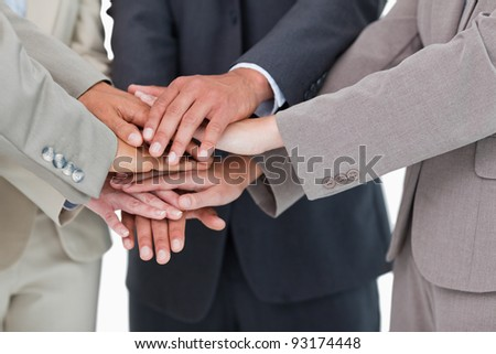 Hands of businesspeople together against a white background