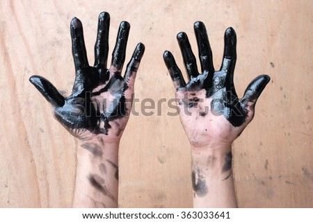 hands of  car oil change - stock photo
